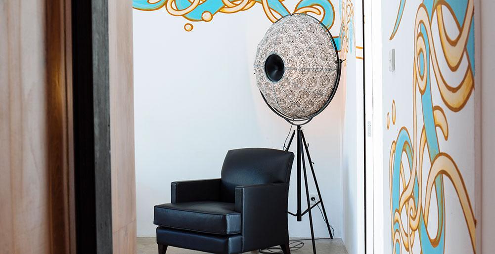 Villa Canggu - Villa North bedroom one corner chair and art