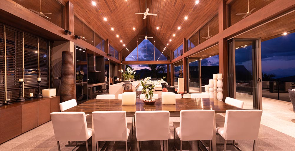 Villa Suralai - Living and dining areas at night