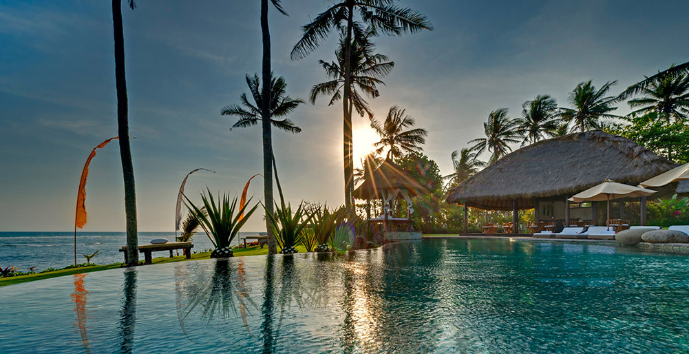 Taman Ahimsa - View across pool at sunset